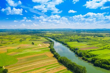 Photo pour Rural countryside landscape in Croatia, Kupa river meandering between agriculture fields, shot from drone - image libre de droit