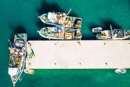 Photo pour Aerial overhead view of fishing ships in town of Biograd na Moru, Croatia - image libre de droit