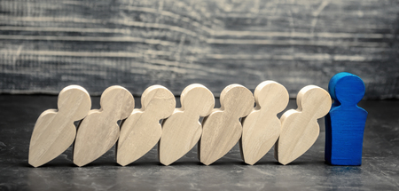 Foto de Leader businessman stops falling dominoes. Strong and reliable boss. Difficulties in business and their solution. Support team. The fall of the crumbling business is saved by leader. - Imagen libre de derechos