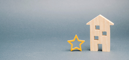 Wooden house and one star. Concept of negative feedback. Low quality and service serving. Evaluation of the critic. Hotel or restaurant rating. Bad critic review. Place for text