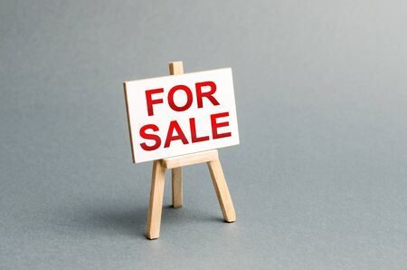 Information stand with an inscription FOR SALE. Announcement of the sale and attracting potential buyers. Advertising campaign. purchase of real estate, assets and goods. Business strategy. Buy house