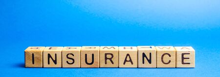 Photo pour Wooden blocks with the word Insurance. Life insurance, health, business, property. Protection and Security Concept - image libre de droit