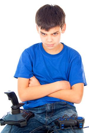 boy sitting with two joysticks