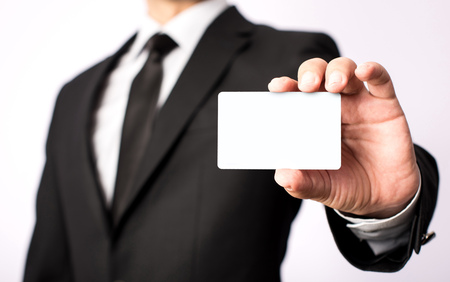 Businessman Showing His Blank Vcard With Available Copy Space