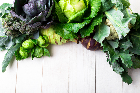 Foto de Various of Cabbage Broccoli Cauliflower. Assorted of Cabbages on white wooden background. Flat lay - Imagen libre de derechos