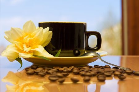 Coffee on a table in a beautiful morning