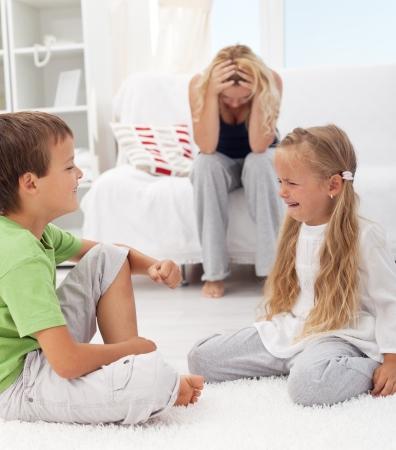 Kids having a quarrel and fight - tough parenthood concept
