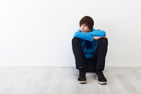 The times when every thought is big - serious teenager boy sitting