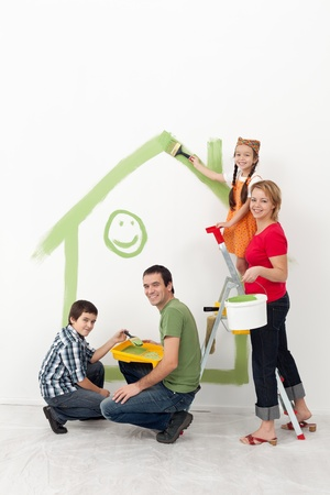 Photo pour Family with kids redecorating their home - smiling with painting utensils - image libre de droit