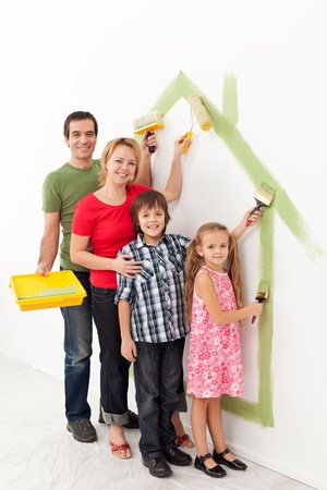 Photo pour Family with kids painting together in their new home concept - image libre de droit
