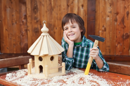 Excellent Happy Boy Building A Bird House For Placing Out Bird Seeds Download Free Architecture Designs Scobabritishbridgeorg