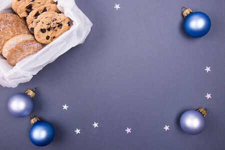 Holidays cookies with christmas decor on a flatlay background. Christmas concept. Copy space.