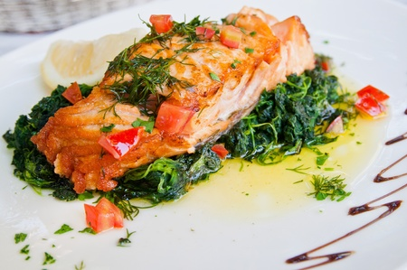 Photo for grilled salmon and lemon - french cuisine dish with tomato and salmon - Royalty Free Image