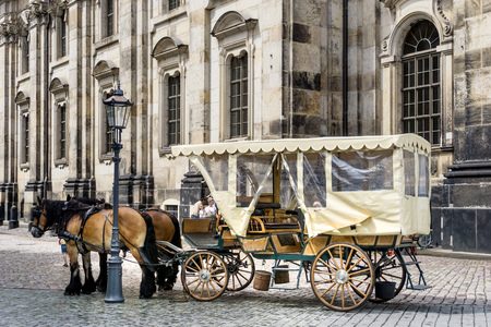 DRESDEN, GERMANY - July 23, 2017: a horse and carriage carries tourists in Dresden, Germany