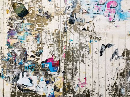 Photo pour Layers of old colorful posters on wall damaged by time for your grunge style design - image libre de droit