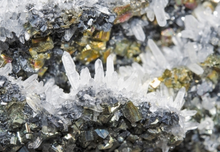 Pyrite and galena absorbed by quartz natural crystalClose-up