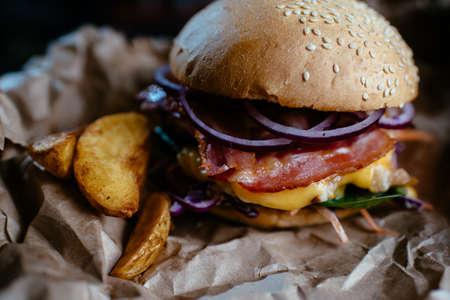 Craft beef burger on black background.