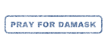 Pray For Damask text textile seal stamp watermark. Blue jeans fabric vectorized texture. Vector tag inside rounded rectangular shape. Rubber sign with fiber textile structure.