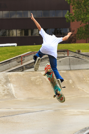 CALGARY, CANADA - JUN 21, 2015: Athletes have a friendly skateboard Show Off in Calgary. California law requires anyone under the age of 18 to wear a helmet while riding a skateboard.