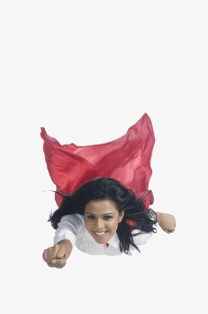 Photo for Portrait of a woman imitating as a superhero - Royalty Free Image