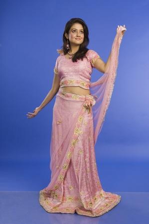 Photo pour Woman posing in traditional dress - image libre de droit