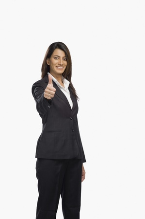 Portrait of a businesswoman gesturing thumbs up sign