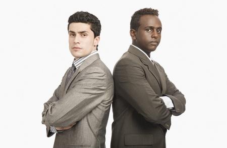Photo pour Two businessmen standing back to back - image libre de droit