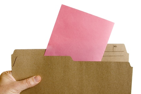 Hand holding file folder with Pink Slip Layoff Notice