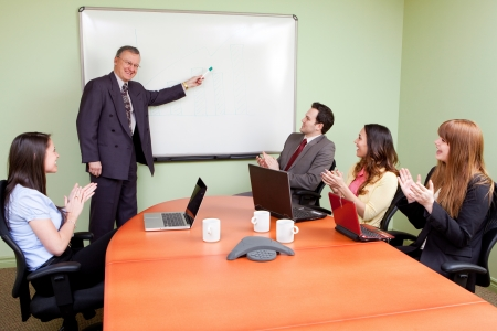 Business team motivated by positive presenter, Clapping employees