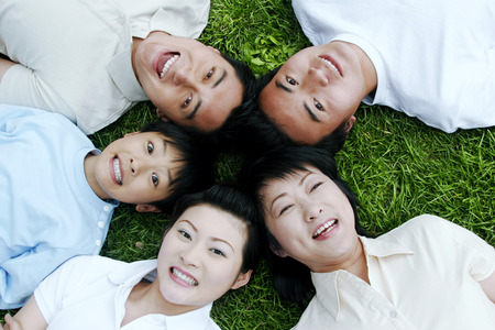 Family lying down in a circle