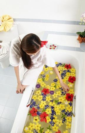 Woman preparing flower bath.