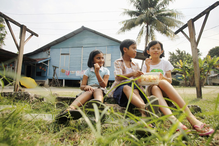 Children sharing snacks