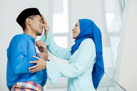 Foto de Mid adult Muslim couple during Eid al-Fitr - Imagen libre de derechos