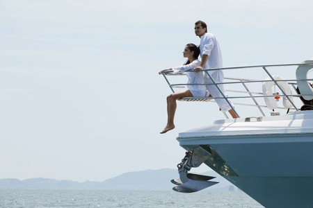 Photo for Couple relaxing at the tip of the yacht - Royalty Free Image
