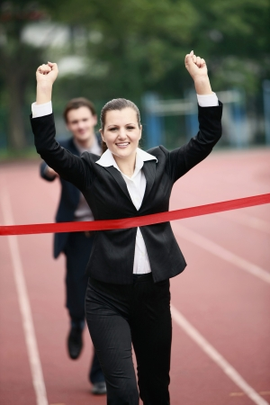 Businesswoman crossing the finishing line