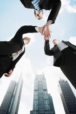 Photo pour Business people with hands together - image libre de droit