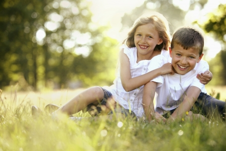 Photo for Boy and girl having fun in the park - Royalty Free Image