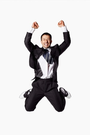Businessman jumping up in joy