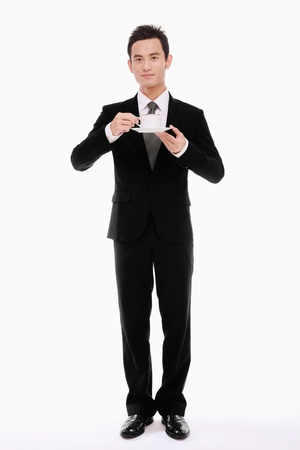 Businessman with a cup of coffeeの写真素材