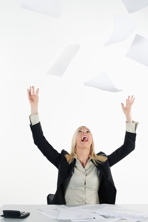 Businesswoman throwing papers in the air