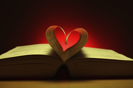 Heart shape formed from pages in book