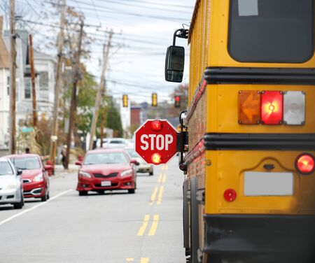 Photo for school bus with stop sign flashing on the street - Royalty Free Image