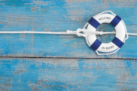 Blue wooden background with  welcome on board  for maritme decoration or teamwor