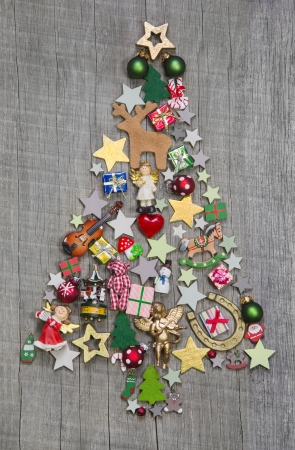 Christmas tree on a wooden background - an idea for a greeting card