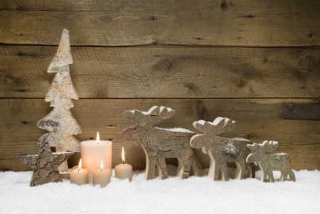 Wooden Christmas tree with elk or reindeer, four candles on wooden for a greeting card