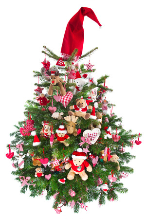 Colorfully decorated isolated Christmas tree with red decoration - traditional in red and green with checkered objects in Country style