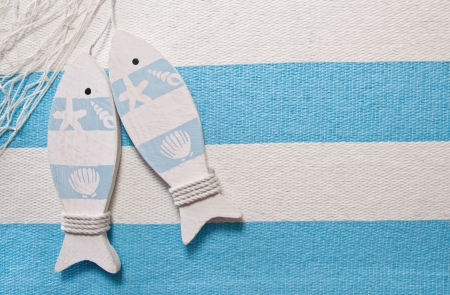 Maritime background or decoration with fish in turquoise