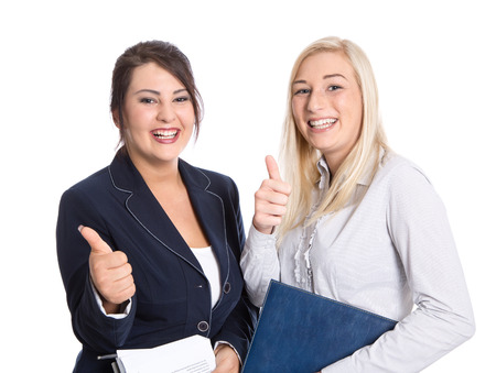 Attractive successful bussineswomen thumbs up and smiling on white