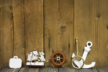 On wooden background maritime decoration for cruising trip.