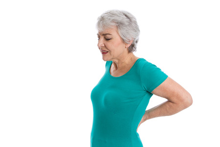 Isolated older woman in green shirt with backache.